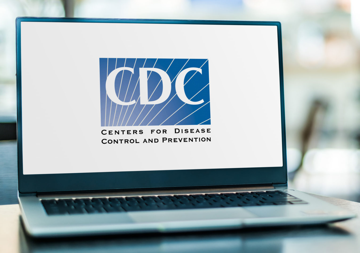 POZNAN, POL - APR 15, 2021: Laptop computer displaying logo of The United States Centers for Disease Control and Prevention, the national public health agency of the USA